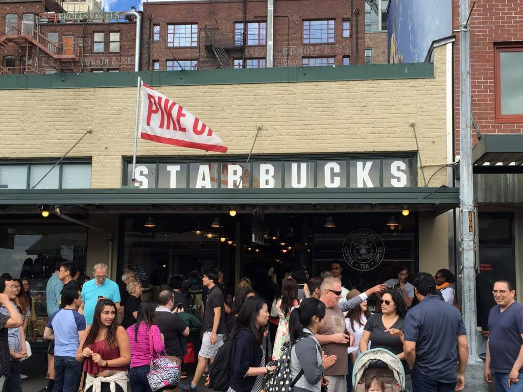 The busy outside of the first Starbucks on Pikes place in Seattle.