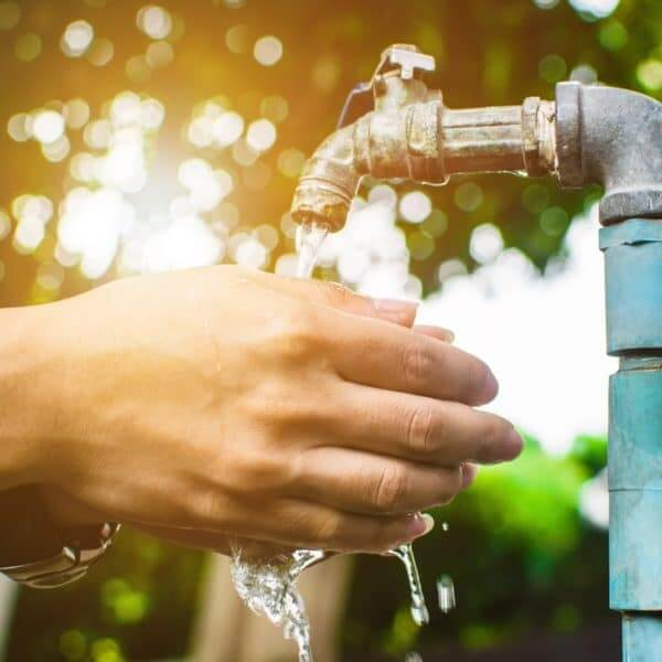 woman washing hands under an RV water pressure regulator