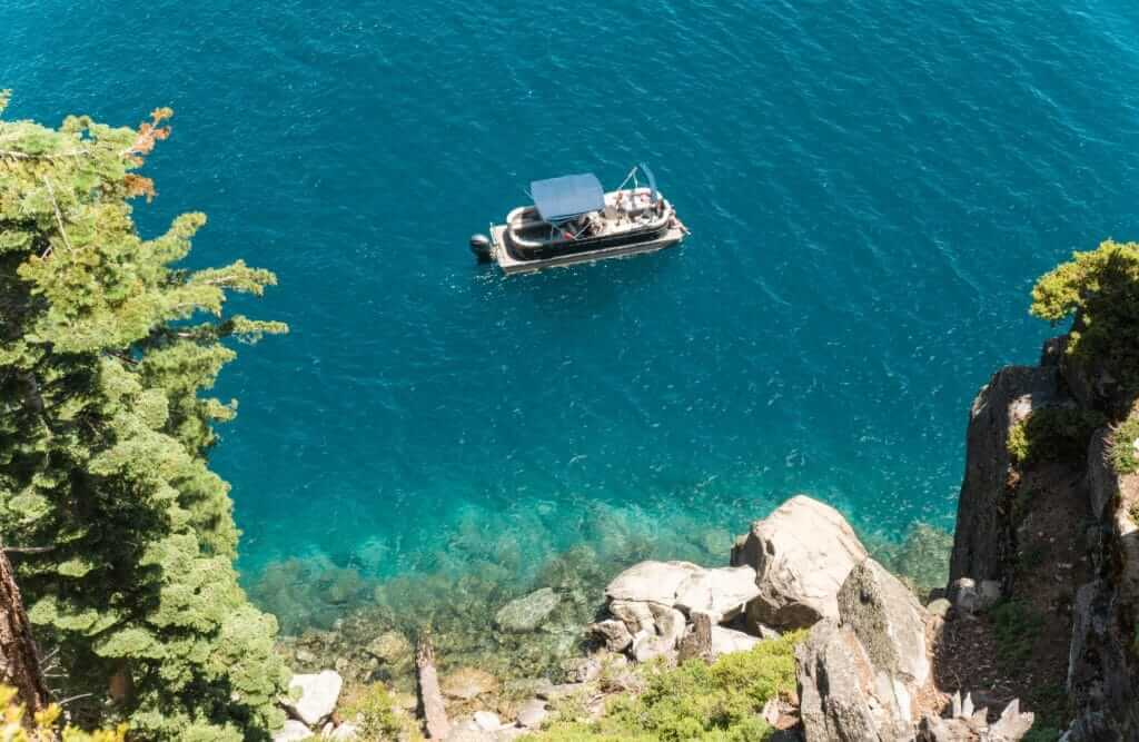Boat on the crystal clear blue water of Emerald Bay in Lake Tahoe